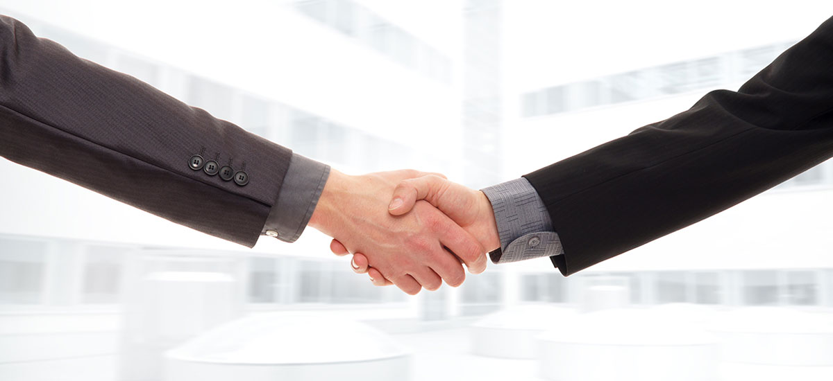 An isolated handshake between two businessmen.