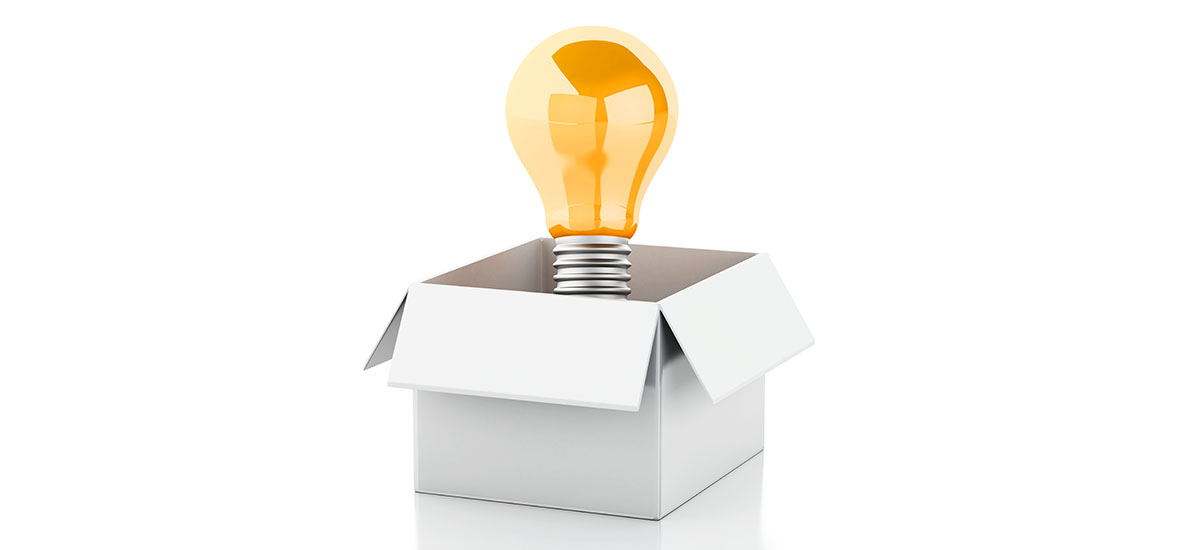 An open cardboard box with a lightbulb coming out of the top.