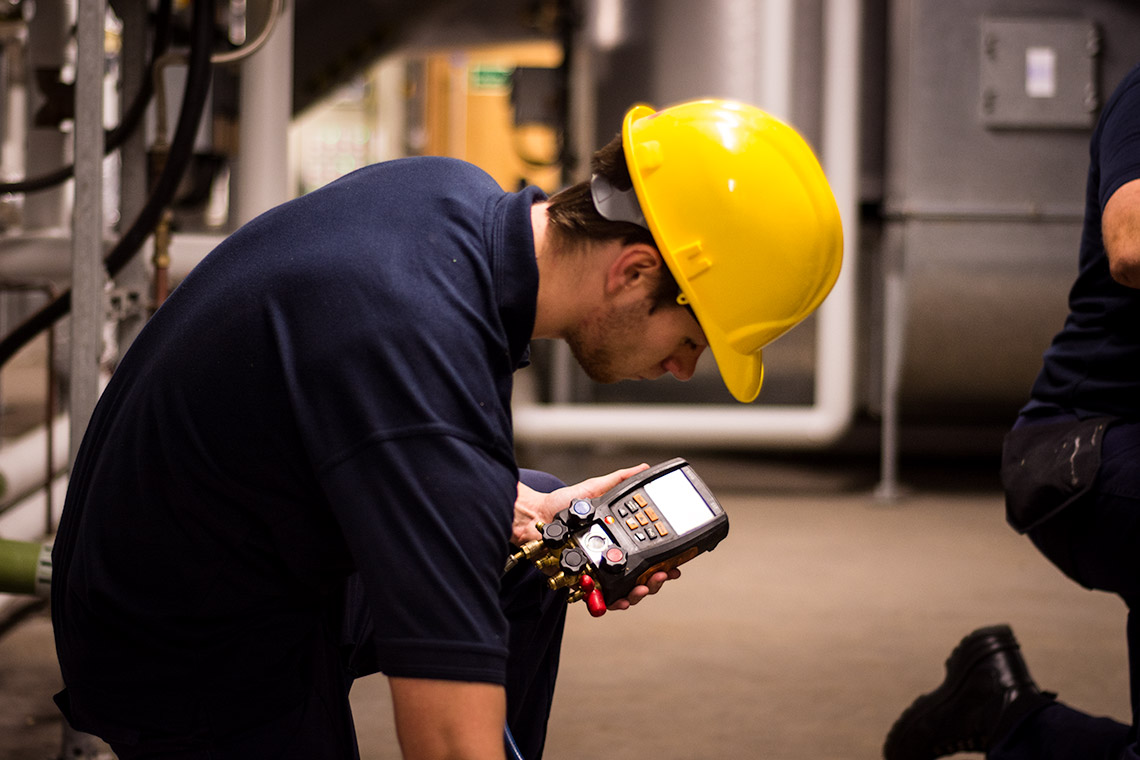 FSG worker testing air conditioning