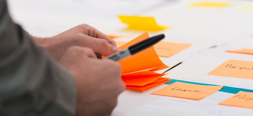 Close up of person using notes to help understand brand definition