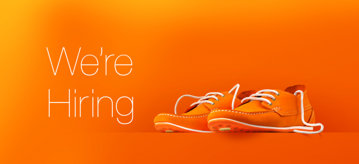 We're Hiring with orange branded shoes.