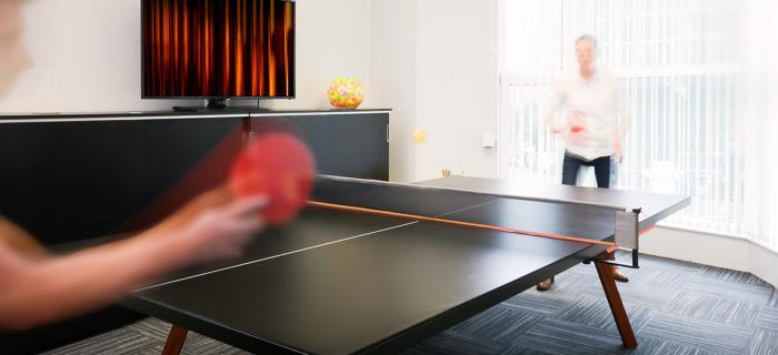 Staff playing ping pong at work