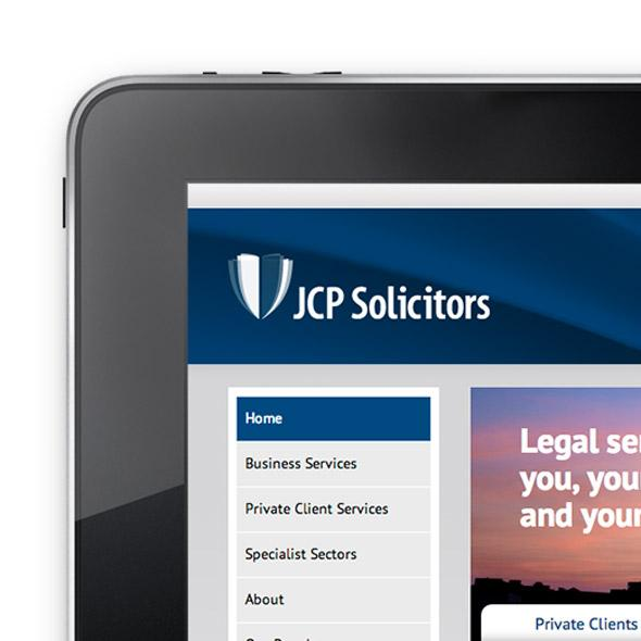 JCP Solicitors website on laptop